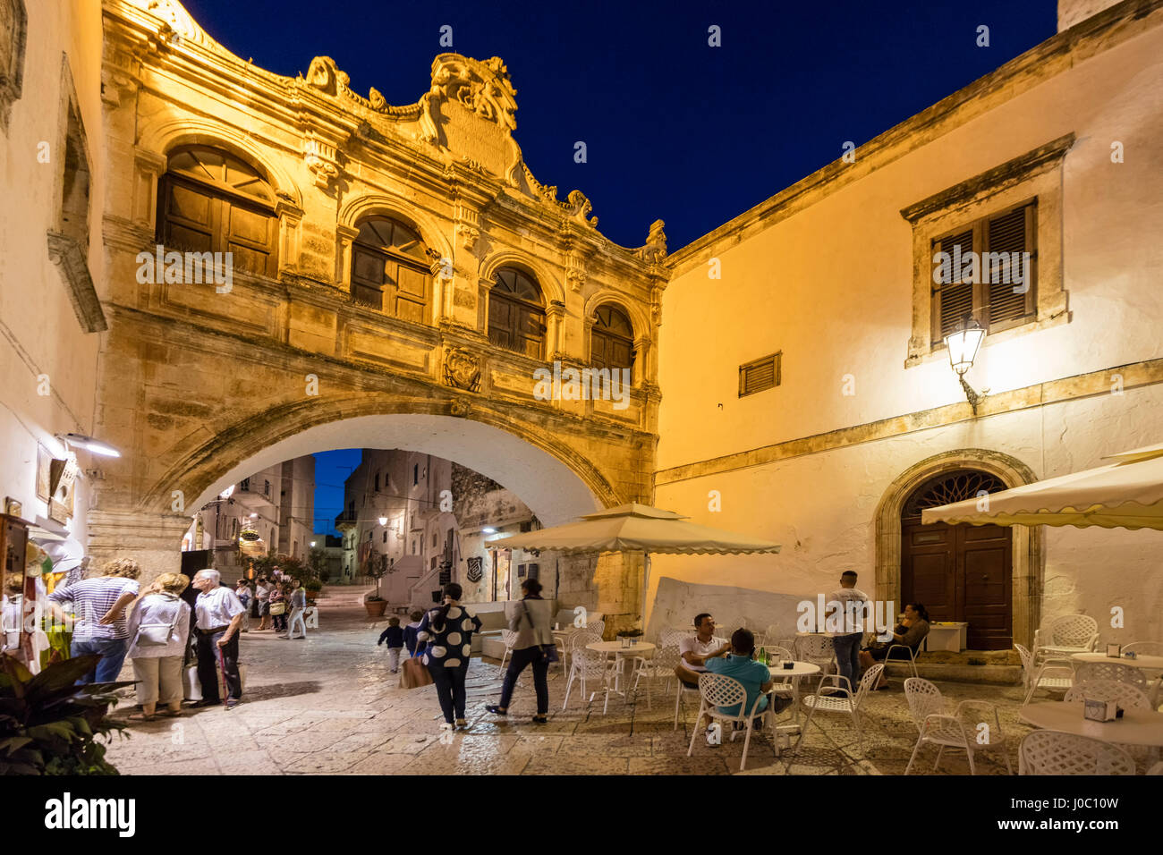 Night view of the typical alleys of the medieval old town, Ostuni, Province of Brindisi, Apulia, Italy - Stock Image