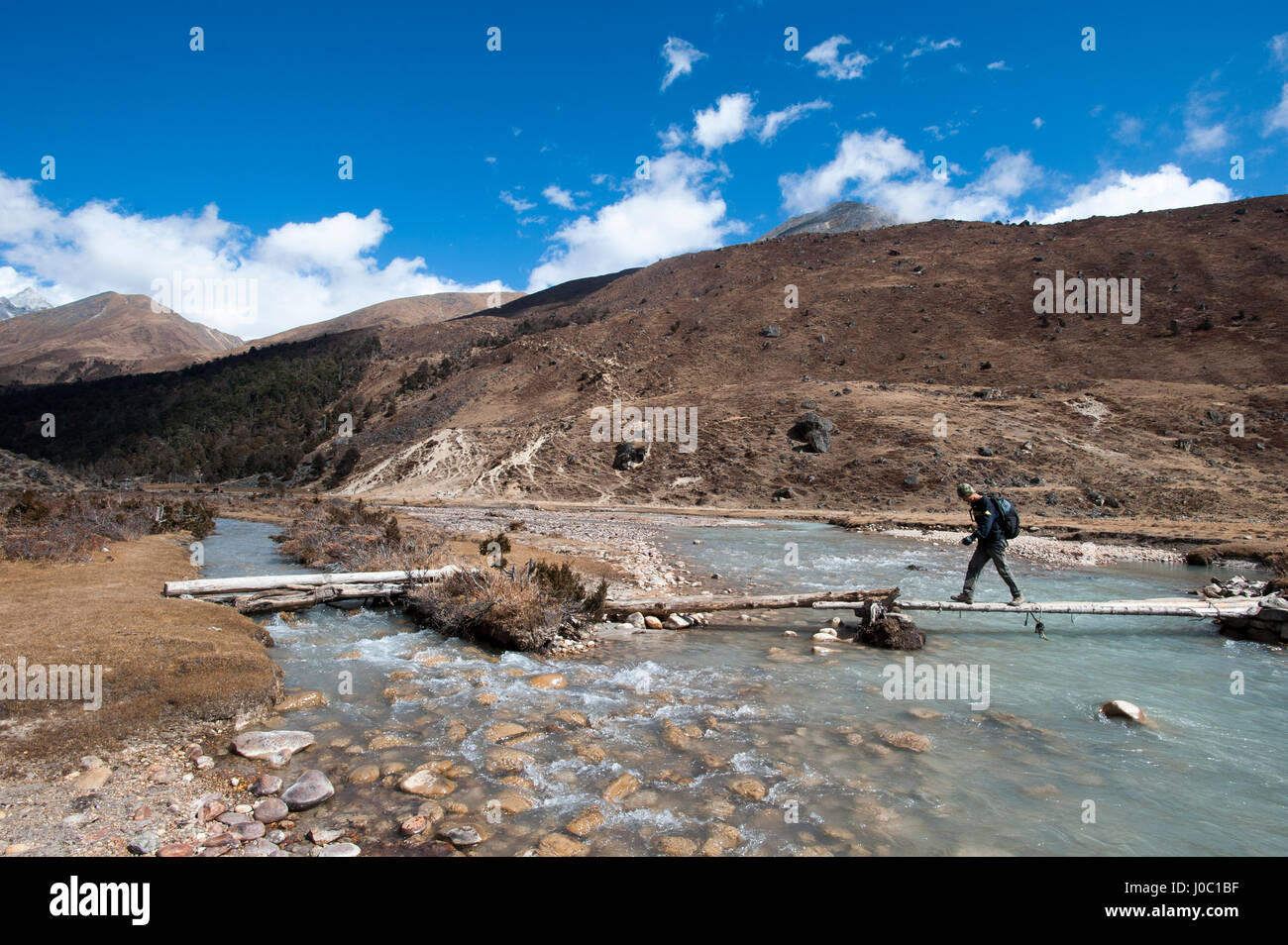 Trekking across a bridge between Shomuthang and Robluthang on the Laya-Gasa trekking route, Gasa District, Bhutan, - Stock Image