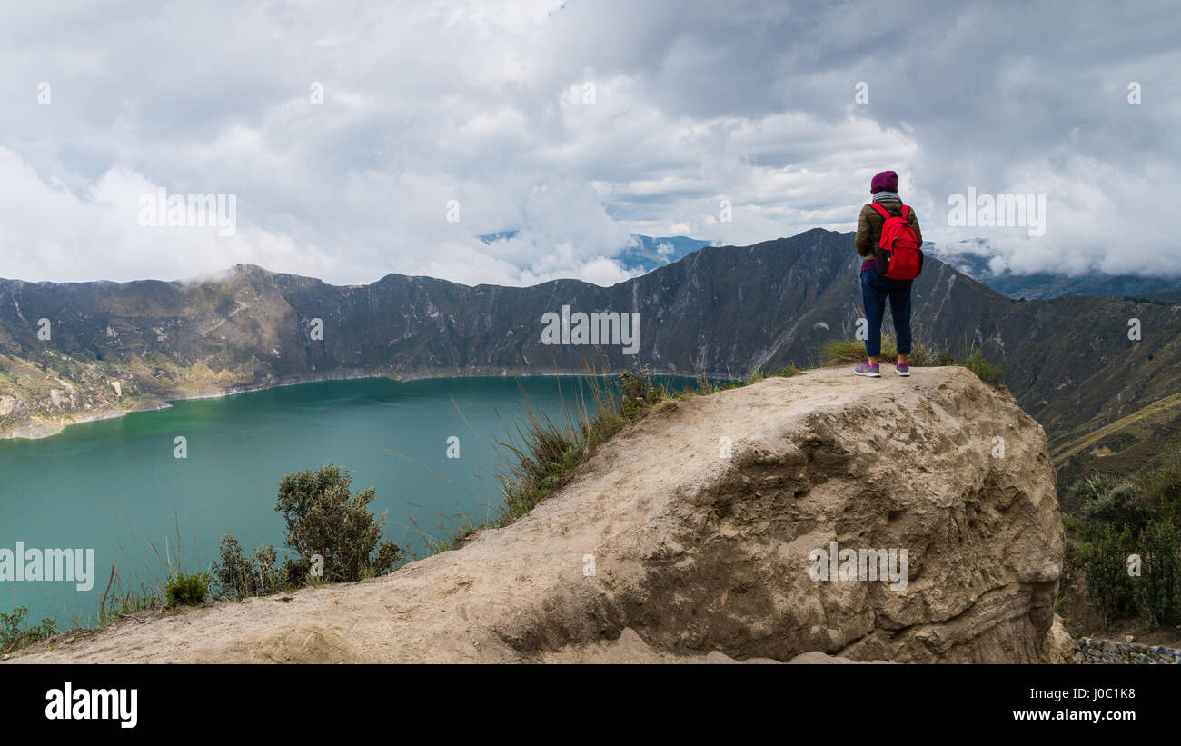 A woman started at Quilotoa, a water-filled caldera and the most western volcano in the Ecuadorian Andes, Ecuador - Stock Image