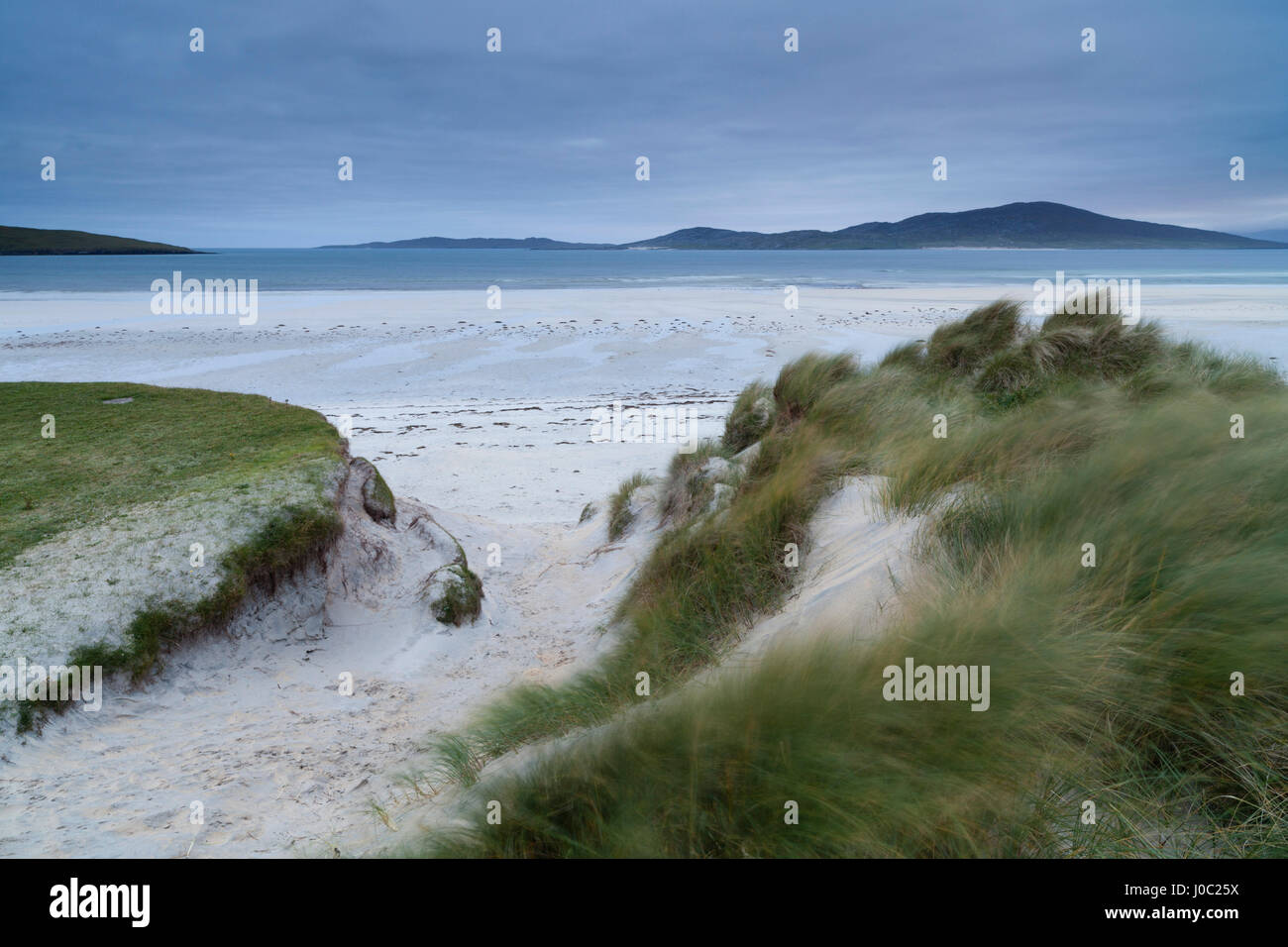 Looking across the dunes and beach towards Taransay from Seilebost, Isle of Harris, Outer Hebrides, Scotland, UK - Stock Image