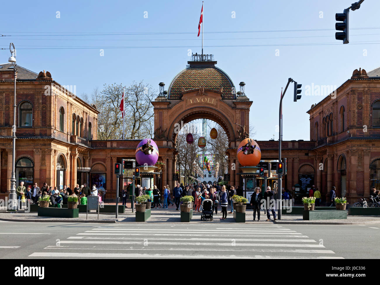 The Tivoli Gardens' main entrance decorated with giant colourful Easter eggs and Easter bunnies on Palm Sunday - Stock Image