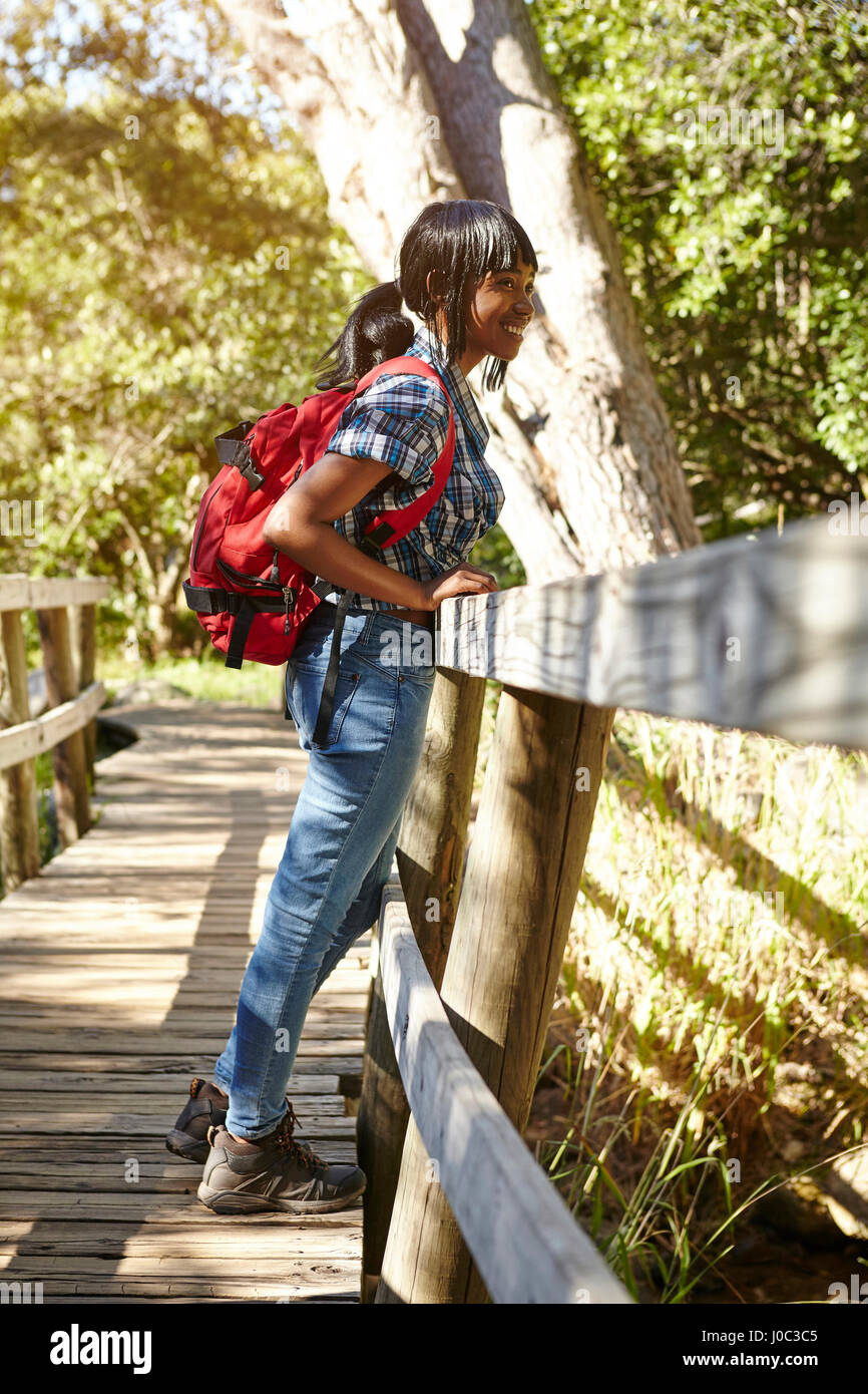 Young woman, hiking, looking at view from bridge, Cape Town, South Africa - Stock Image