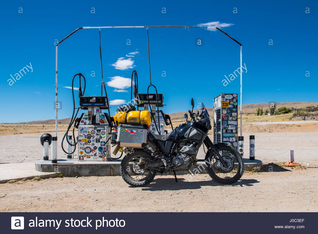 Touring motorbike at petrol station on Route 40, El Chalten, Route 40, Santa Cruz province, Argentina - Stock Image