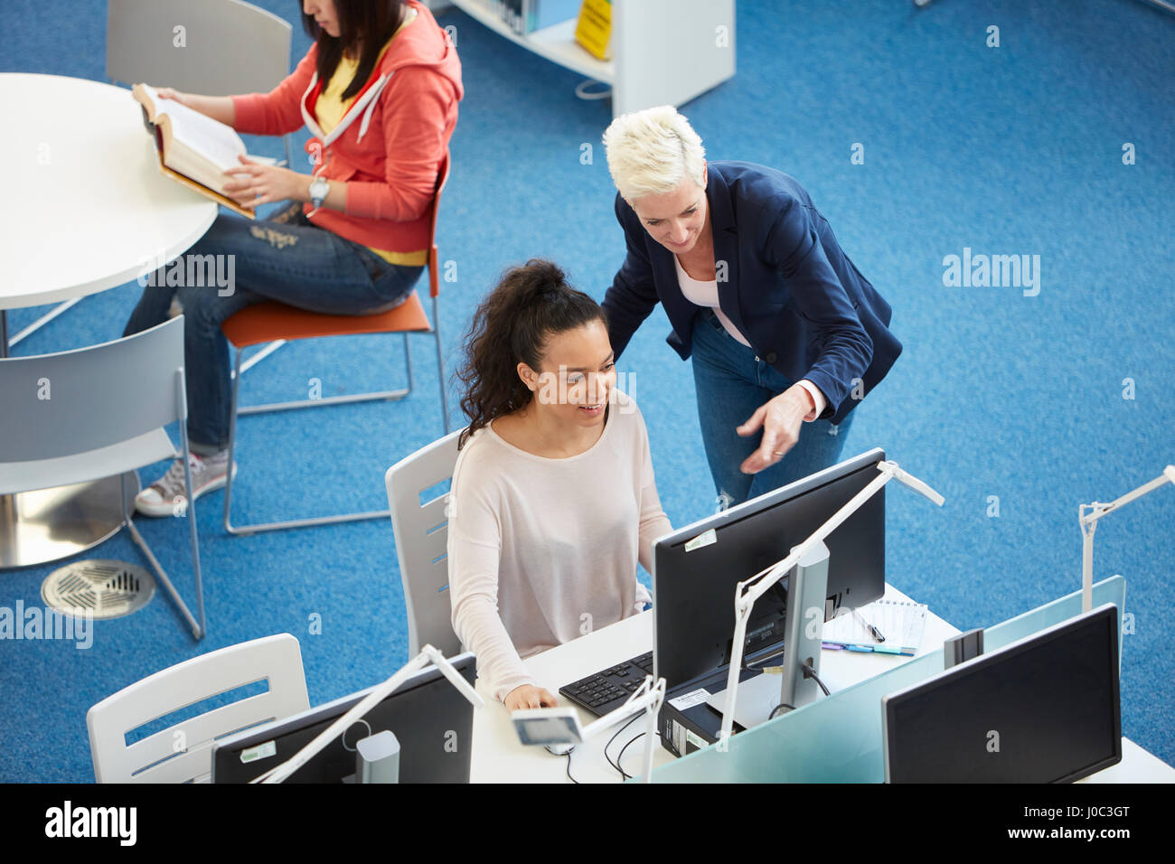 University students working in library - Stock Image