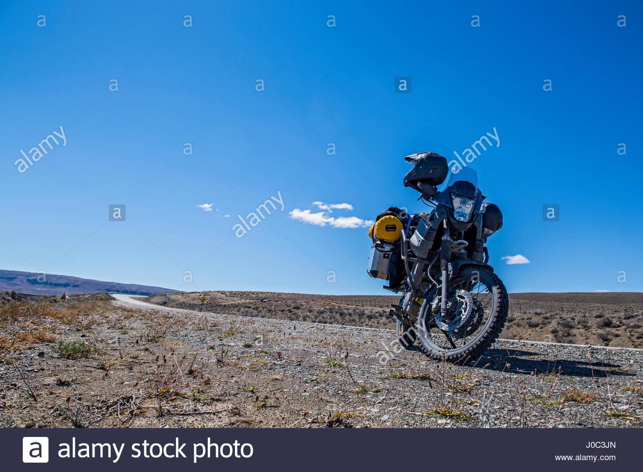 Touring motorbike parked aside 'Route 40', El Chalten, Route 40, Santa Cruz province, Argentina - Stock Image