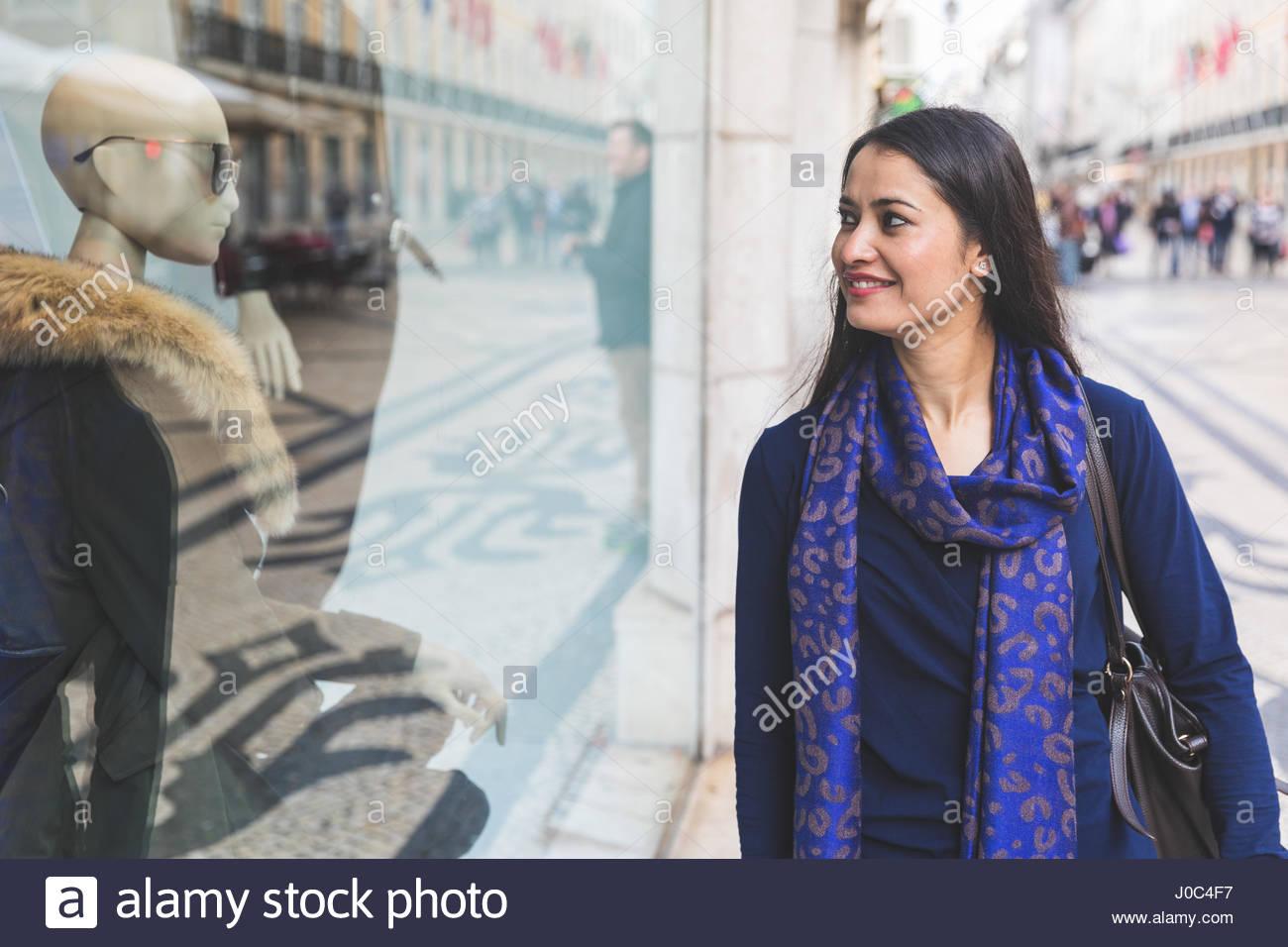 Woman window shopping, Lisbon, Portugal - Stock Image