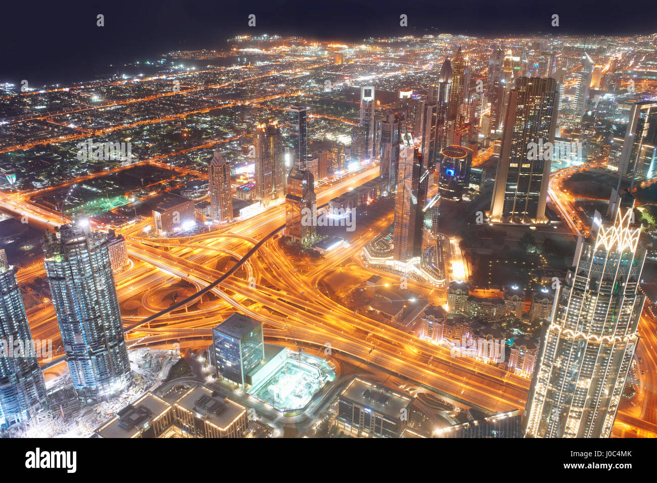 Cityscape at night showing light trails, elevated view, Dubai, UAE - Stock Image