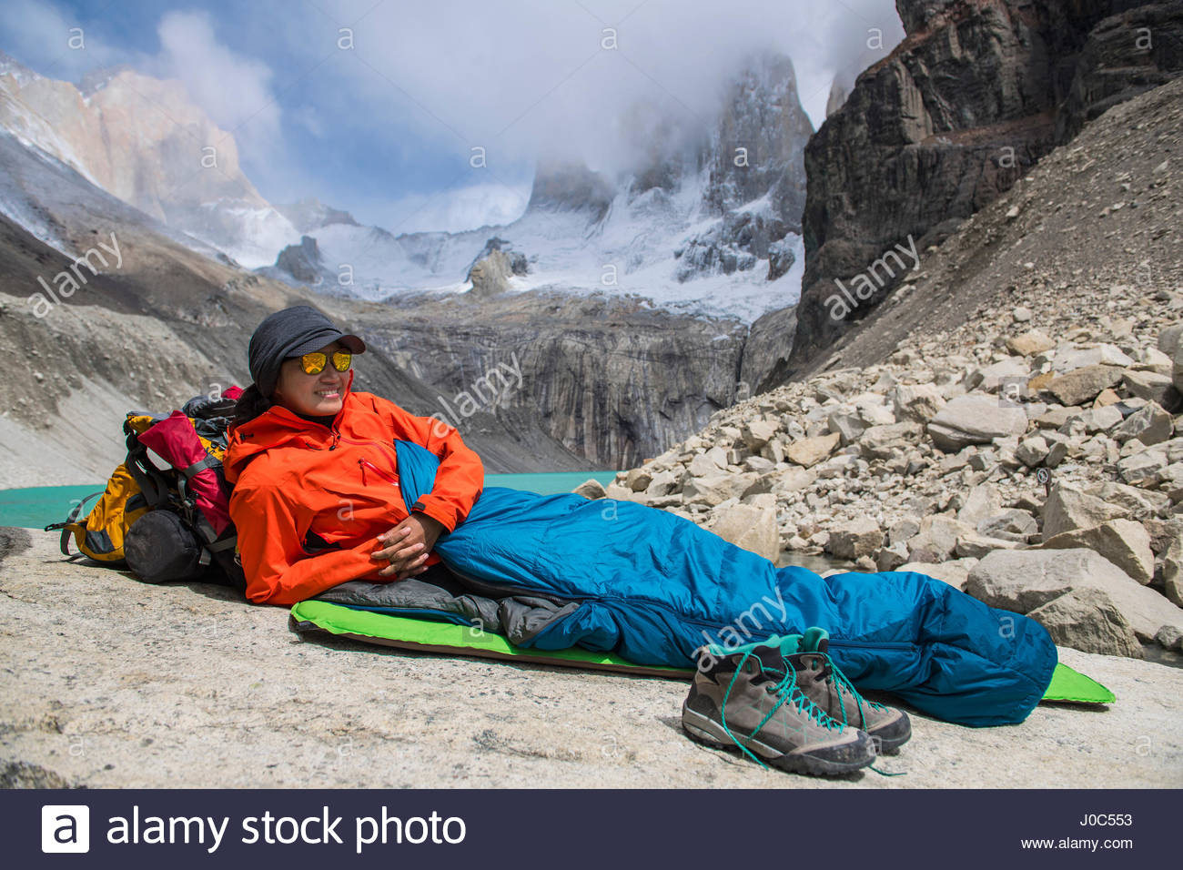 Female hiker camping out at Torres del Paine National Park, Patagonia, Chile - Stock Image