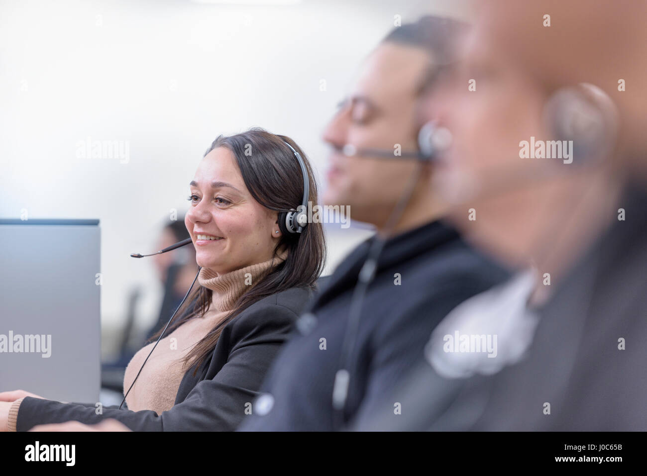 Operators in automotive call centre in car factory - Stock Image