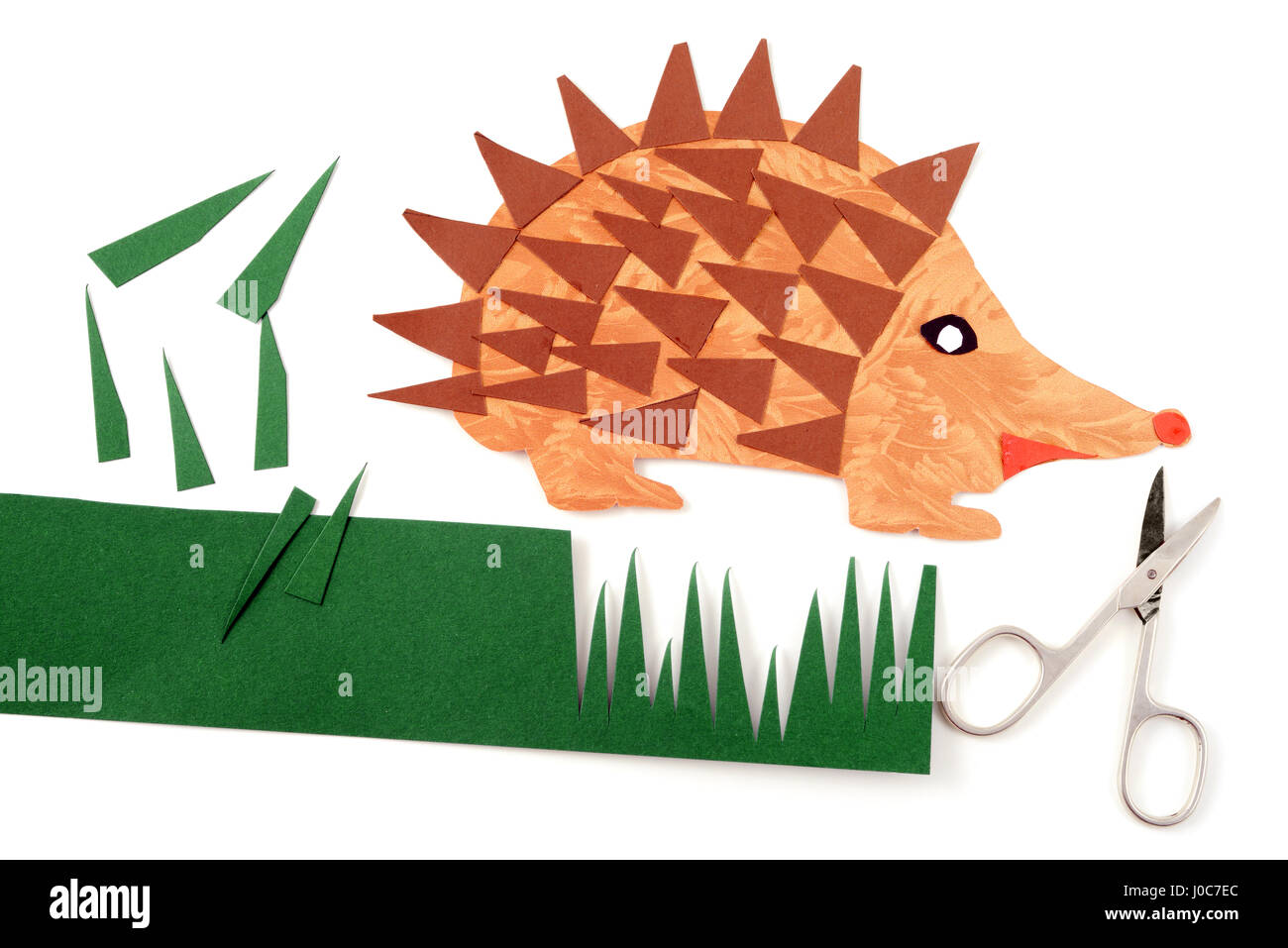 tinker a hedgehog with paper and scissors. - Stock Image