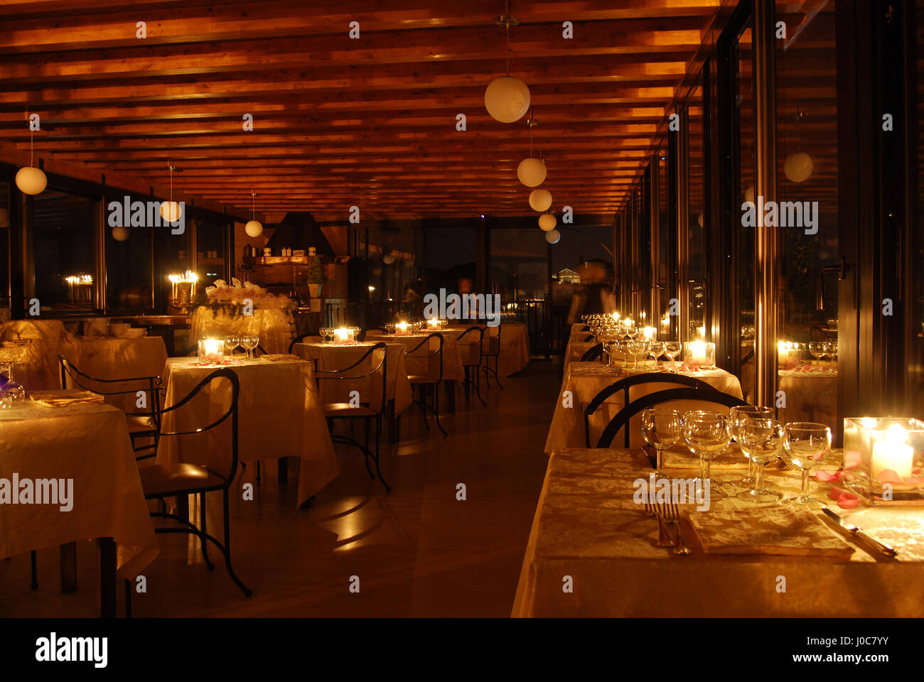 Superb Set Tables Of An Elegant Restaurant By Candlelight