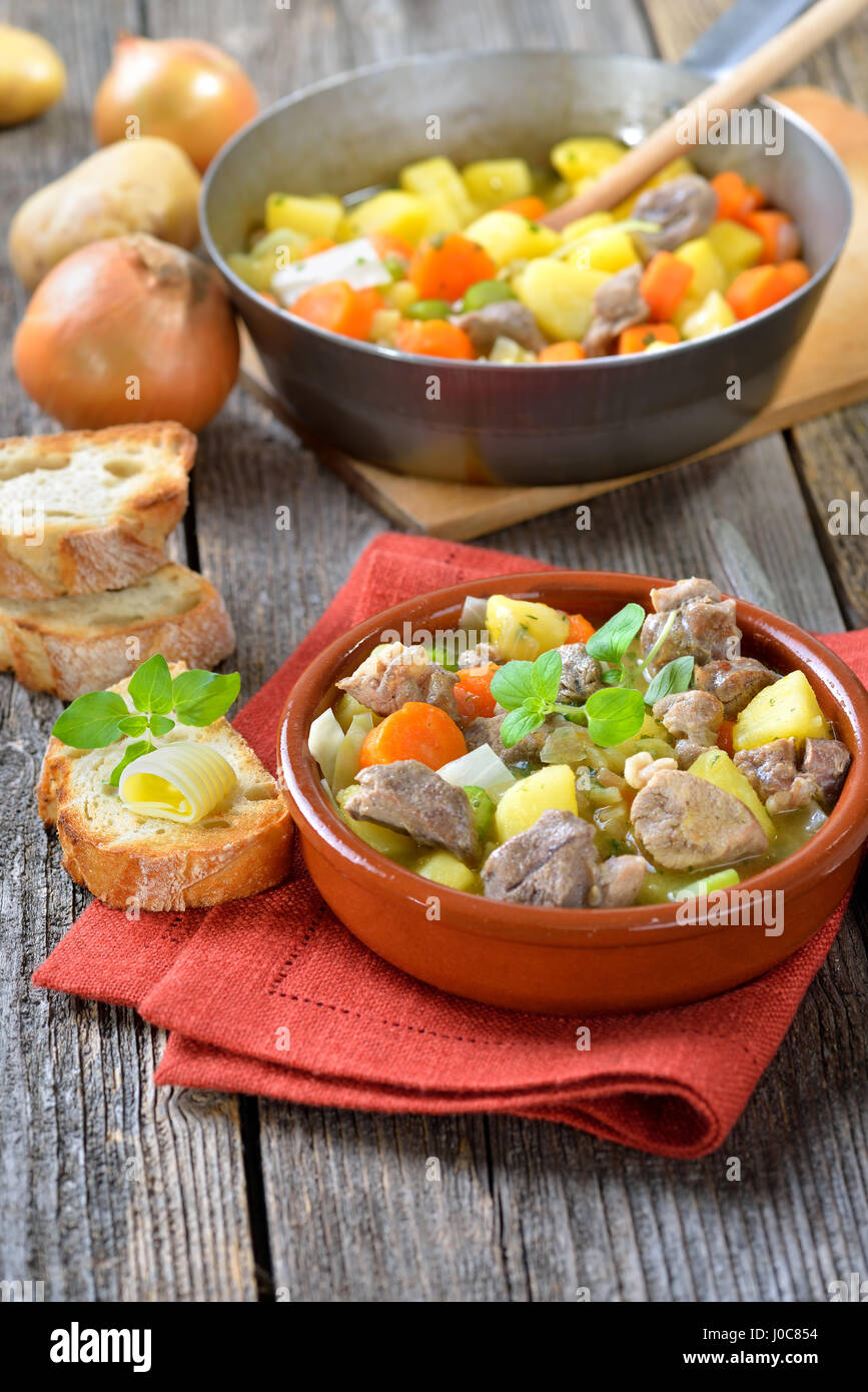 Homemade and slow cooked Irish stew with lamb, potatoes and other vegetables - Stock Image