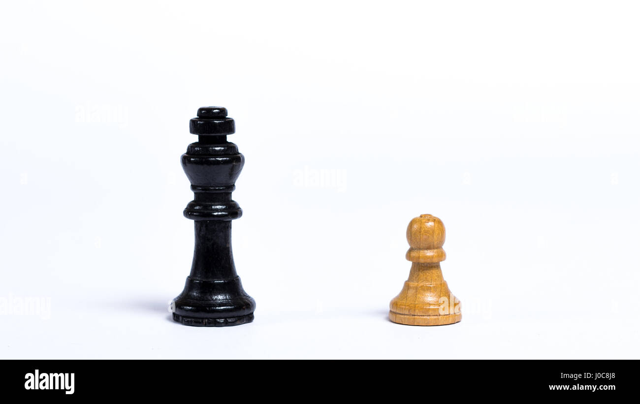 Chess pieces in front of white background - concept of bravery - Stock Image