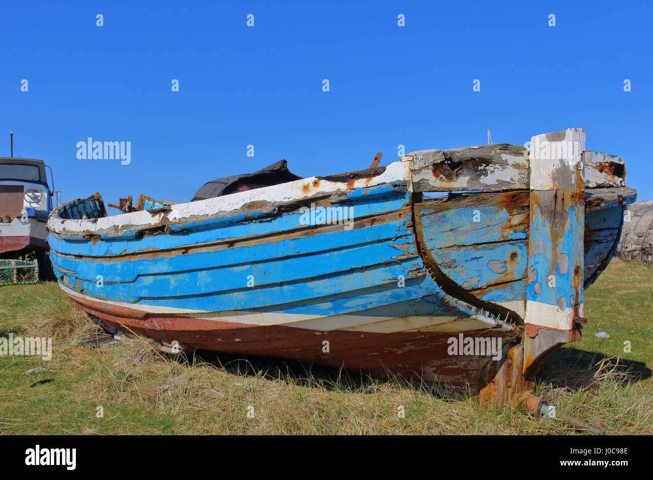Boat that has seen better days on Lindisfarne; UK - Stock Image