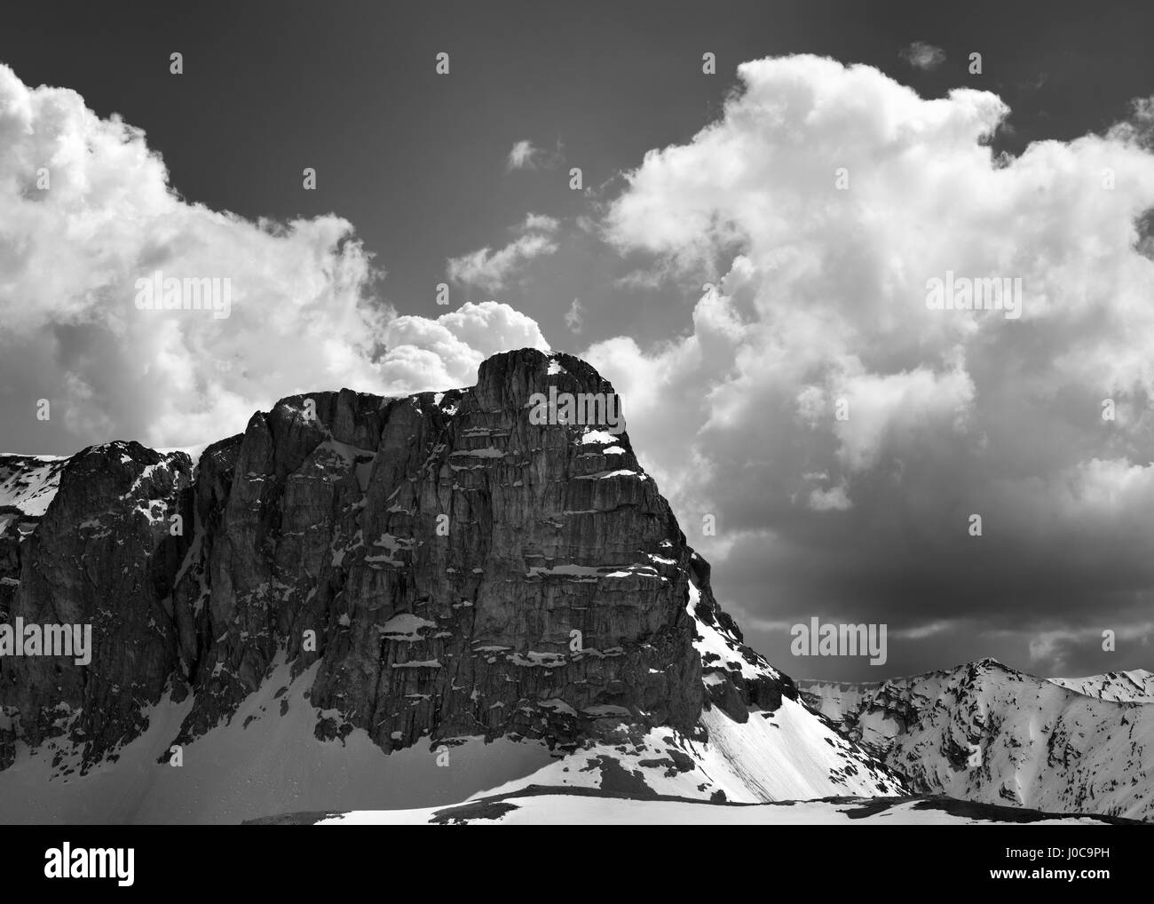 Black and white view on snowy rocks and sky with clouds in nice spring day turkey central taurus mountains aladaglar anti taurus plateau edigel