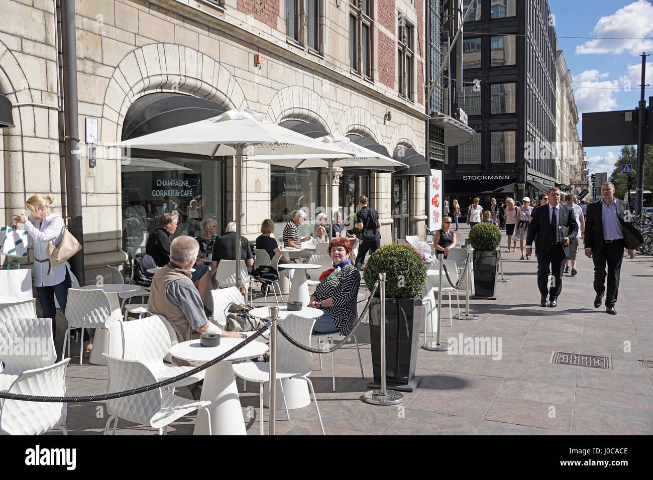 Downtown Helsinki outdoor cafe at Stockman Department Store. - Stock Image
