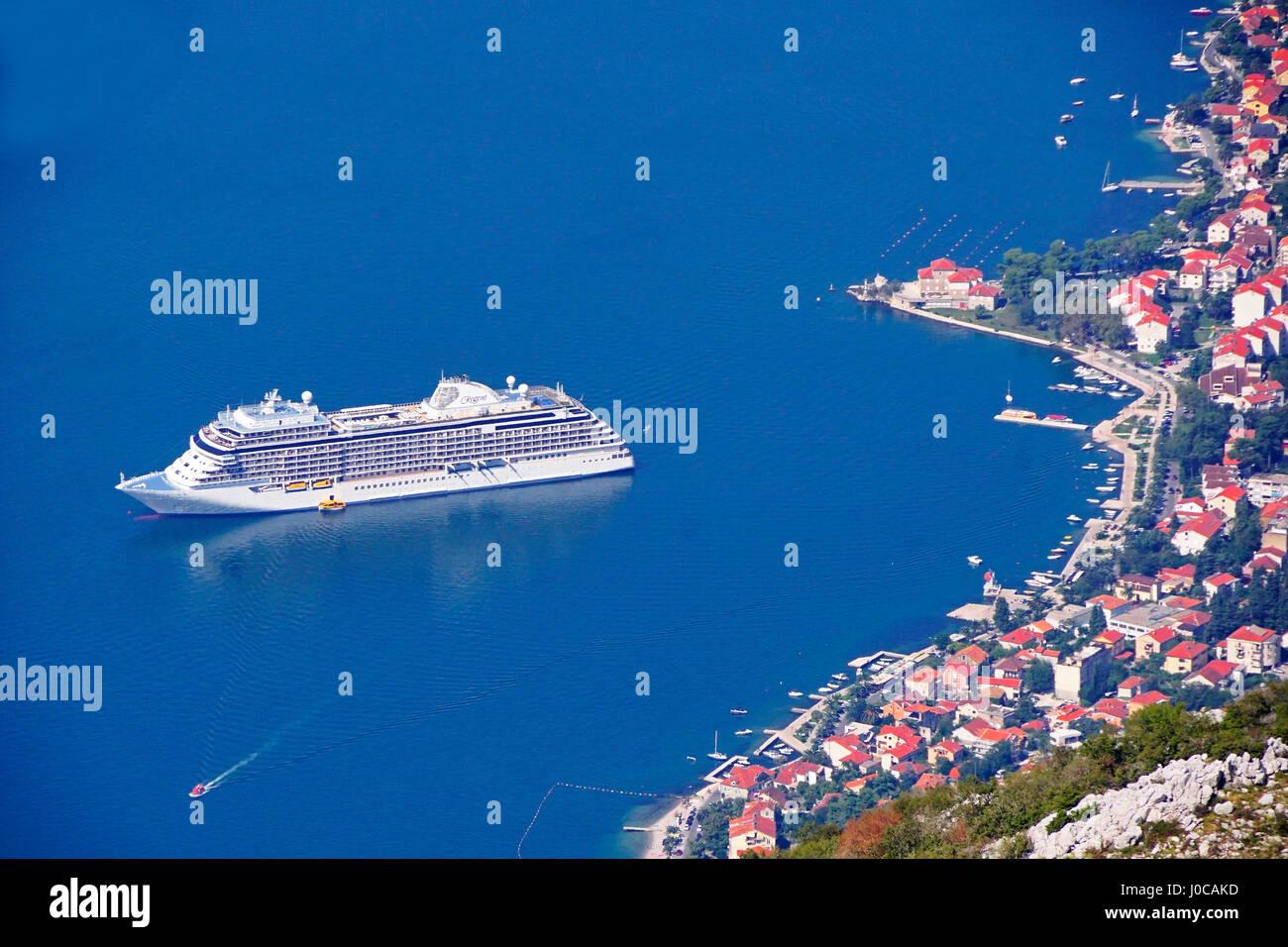 Regent's Seven Seas Explorer luxury cruise ship in harbor of Bay of Kotor, Montenegro. Stock Photo
