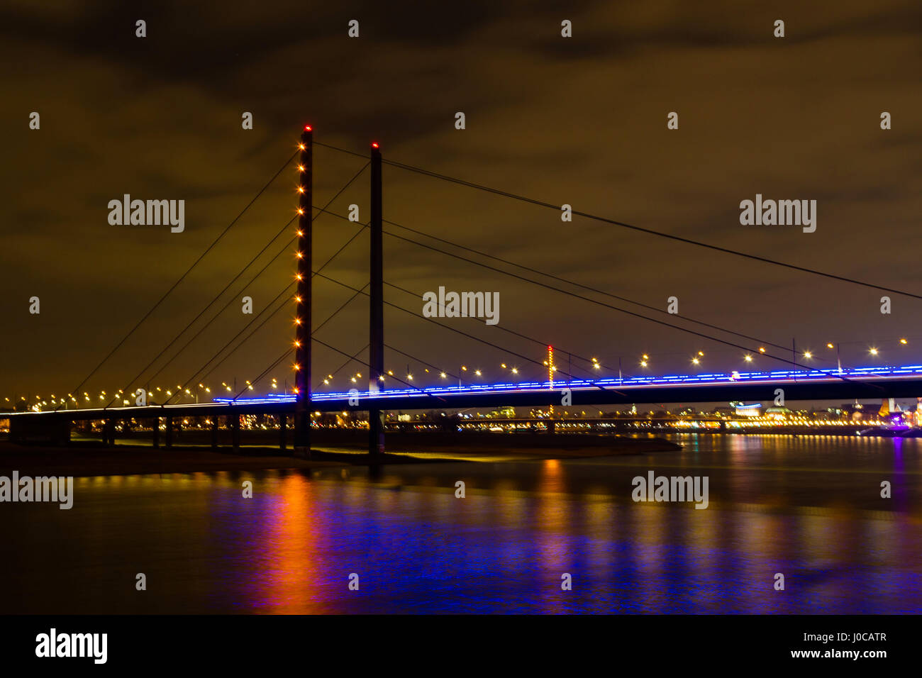 Rhine bridge at night in Dusseldorf, Germany Stock Photo