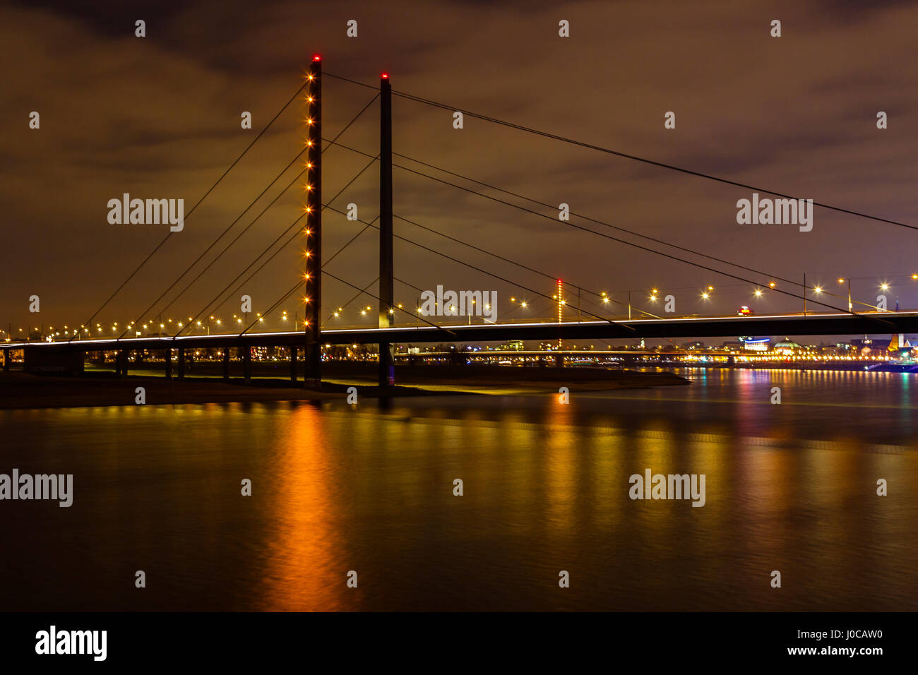 Rhine bridge at night in Dusseldorf, Germany Stock Photo