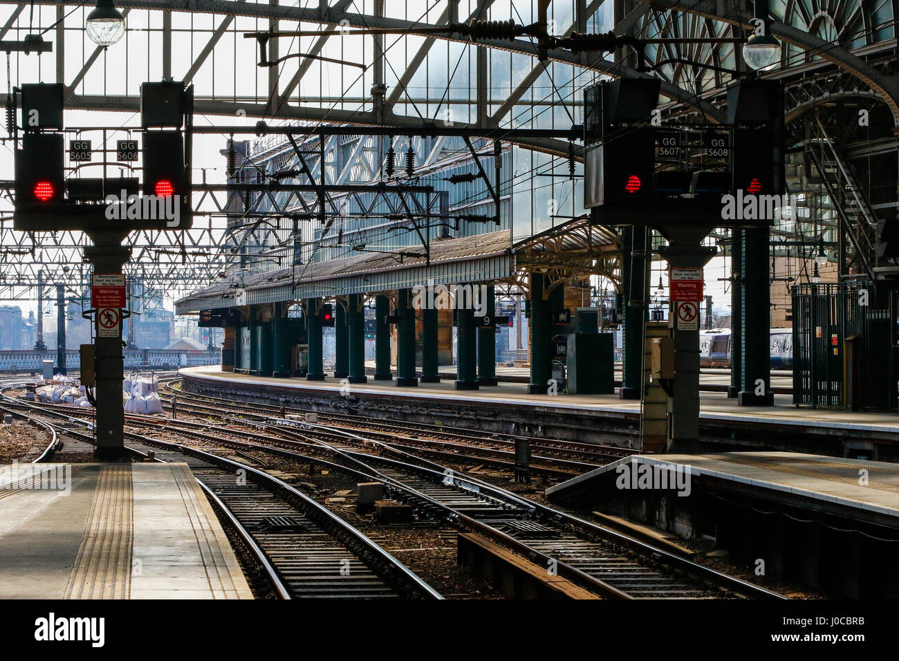 Glasgow central railway station with platforms and rail lines, also showing red light, Glasgow, Scotland, UK - Stock Image