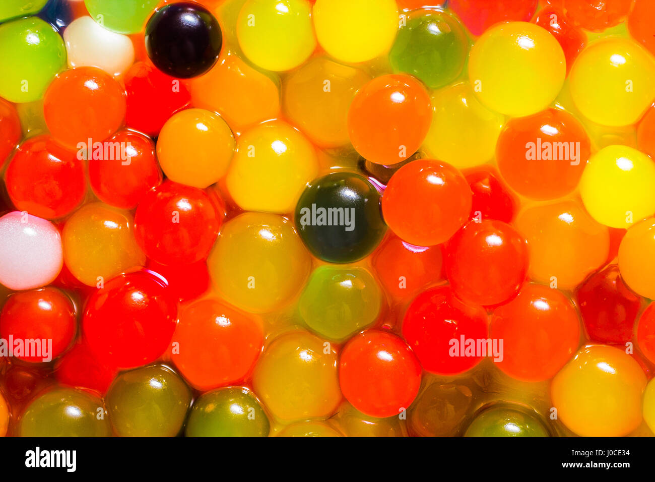 magic growing jelly balls, colorful abstract background - Stock Image