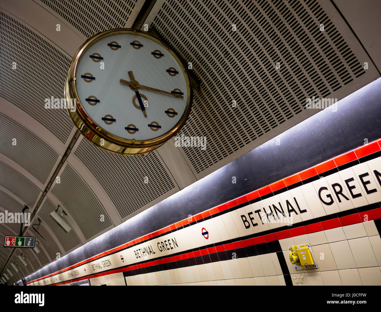 Unusual vintage platform brass clock at Bethnal Green London Underground station in the East End of London - Stock Image