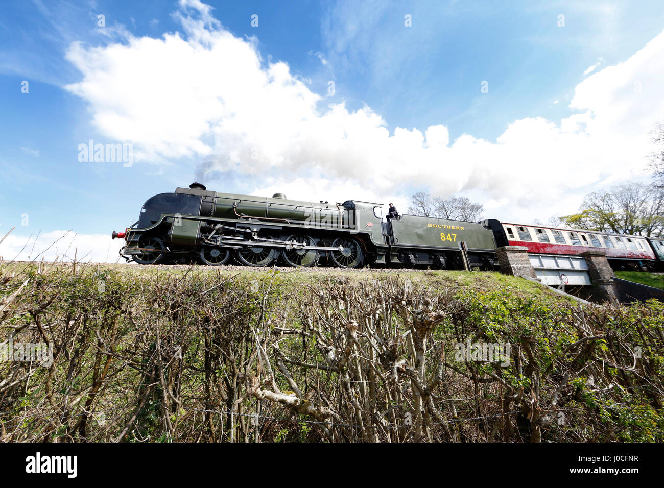 Southern Railway Maunsell S15-class 4-6-0 No.847 Locomotive travels along the Bluebell Railway. - Stock Image