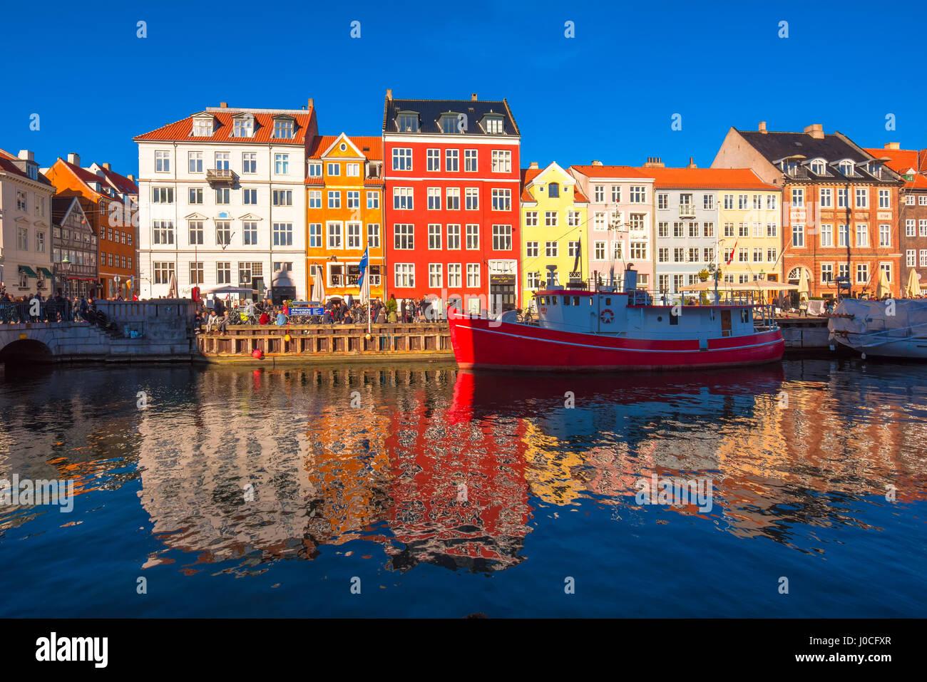 COPENHAGEN, DENMARK - MARCH 11, 2017: Copenhagen Nyhavn district. Nyhavn was constructed by King Christian V from - Stock Image