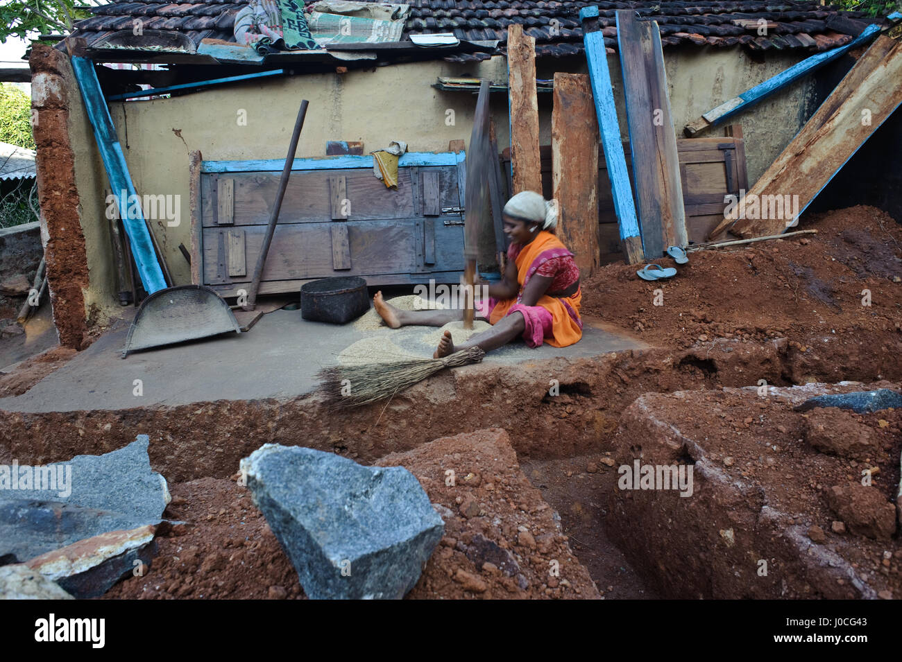 Tribal girl pounding rice at home ( India) She belongs to the Gadaba tribe. - Stock Image