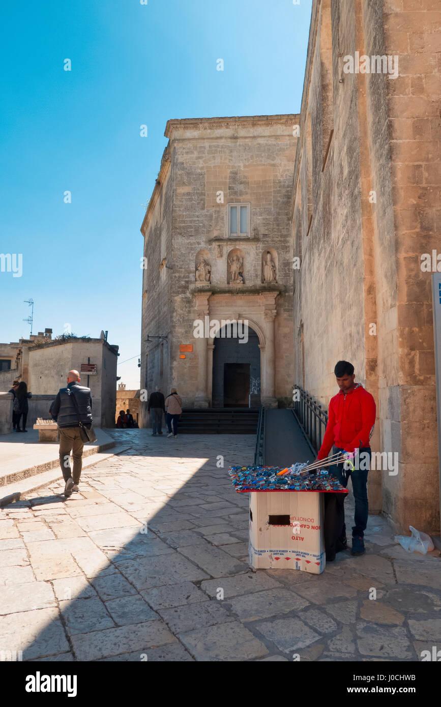 Eastern Matera street vendor who sells glasses. - Stock Image
