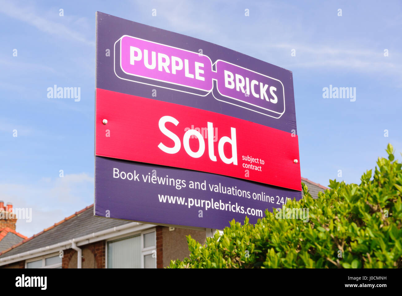 Purple Bricks Group PLC estate agents sold sign the company is the UKs first online property agent launched in 2014 - Stock Image
