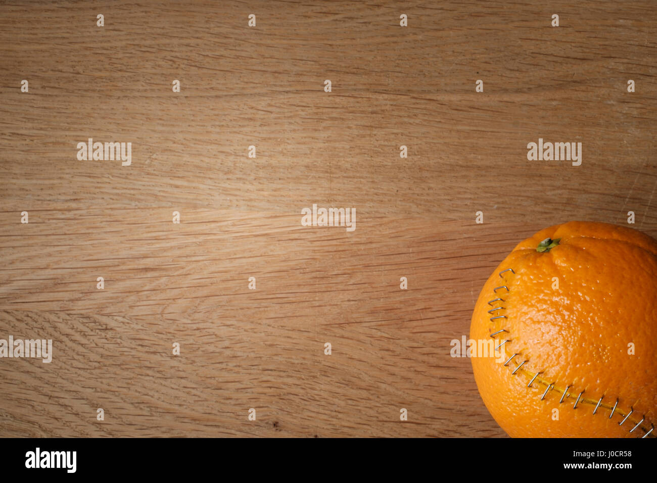orange with stainless steel stitches that hold the husk together Stock Photo