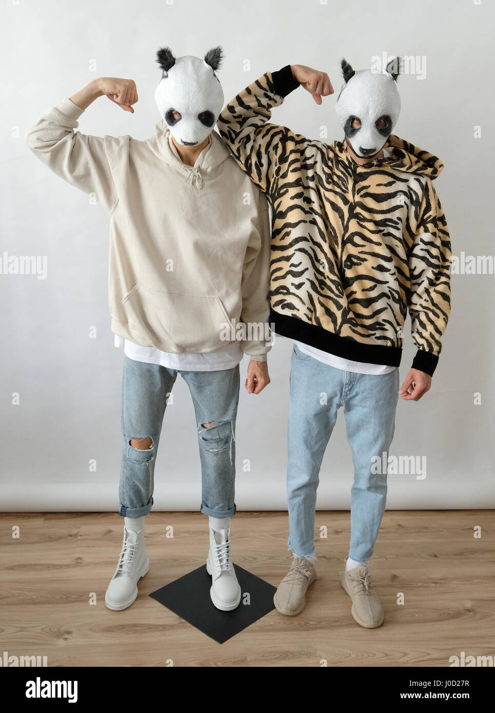Stuttgart, Germany. 11th Apr, 2017. The rapper Cro, wearing a tiger print sweater and a mask, with a wax likeness - Stock Image