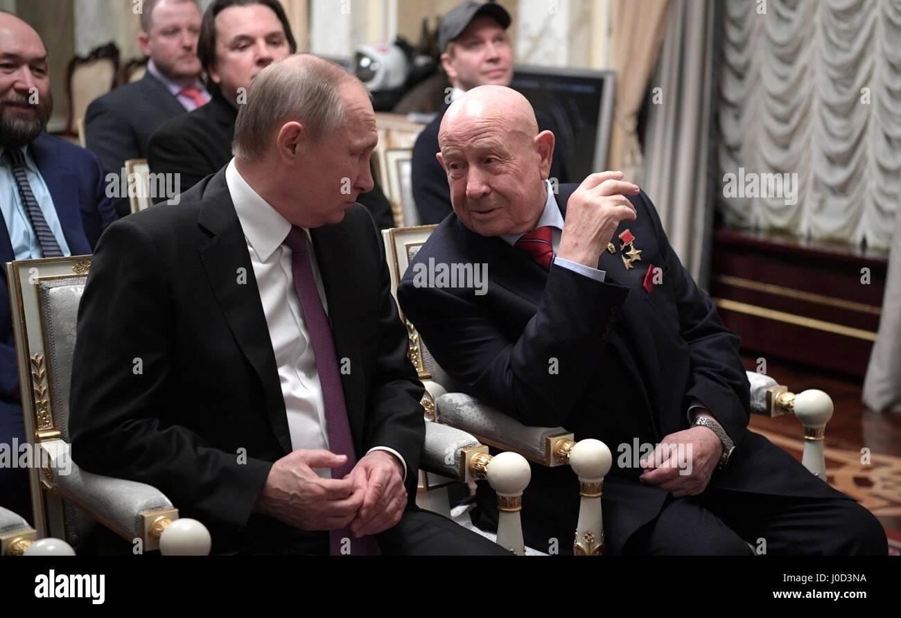 Moscow, Russia. 12th Apr, 2017. April 12, 2017. - Russia, Moscow. - Russian President Vladimir Putin and cosmonautics veteran Aleksey Leonov (right) at a screening of 'The Spacewalker'. Credit: Russian Look Ltd./Alamy Live News Stock Photo