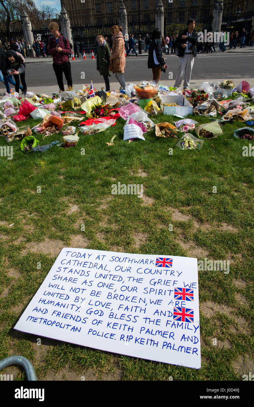 London, UK - April 11th, 2017: Memorial in front of the Houses of Parliament, to the 6 dead, including police officer Stock Photo