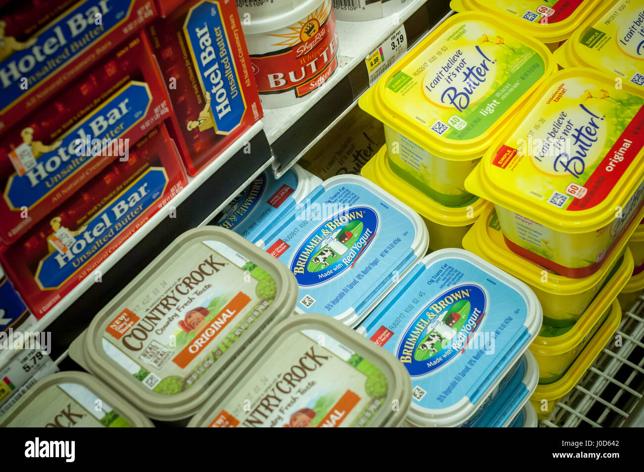 Tubs of  Unilever spreads in a supermarket cooler on Saturday, April 8, 2017. Unilever recently announced that it - Stock Image