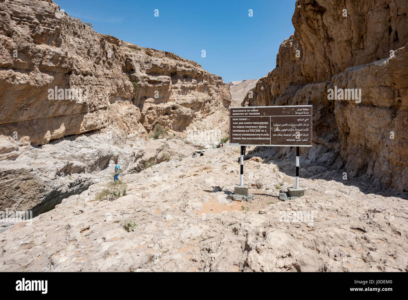 Information baord by the ministry of Tourism in Wadi Bani Khalid, Oman - Stock Image