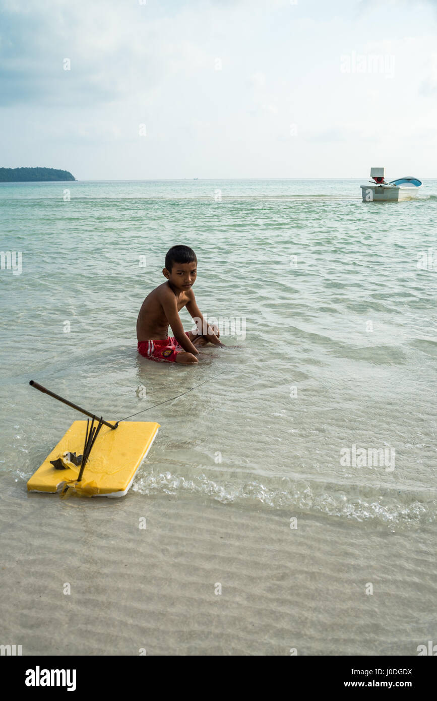 Local kid on the beach of the Koh Rong Sanloem island, Cambodia, Asia. Stock Photo