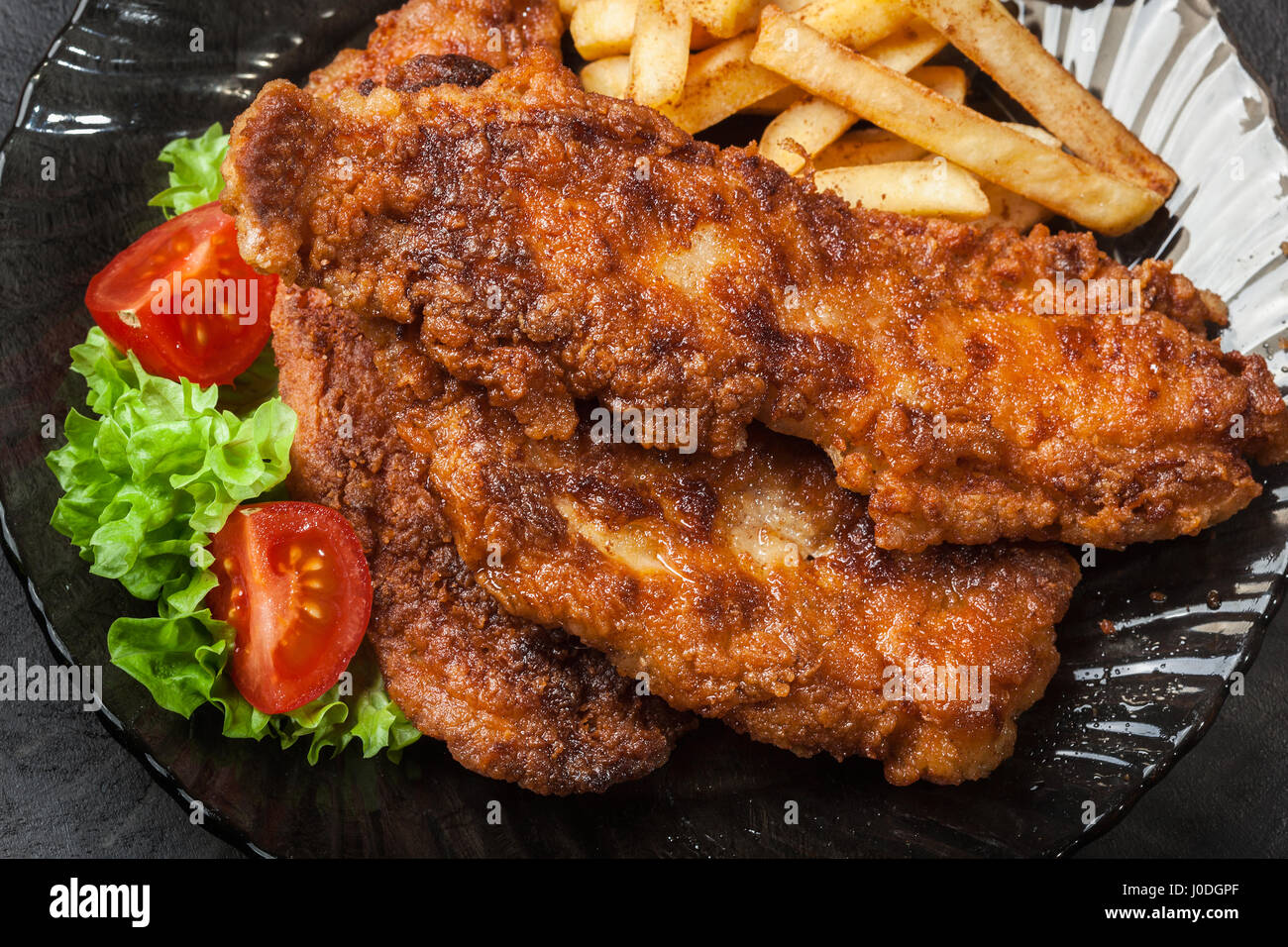 Fried fish in crispy batter with chips on a plate Stock Photo