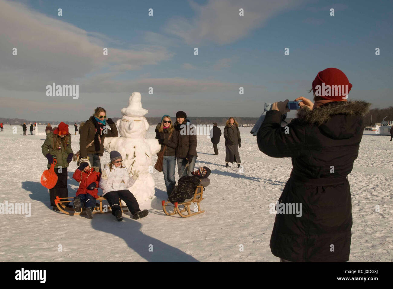 Winterfun with big snowman on the frozen Wannsee in Berlin - Stock Image