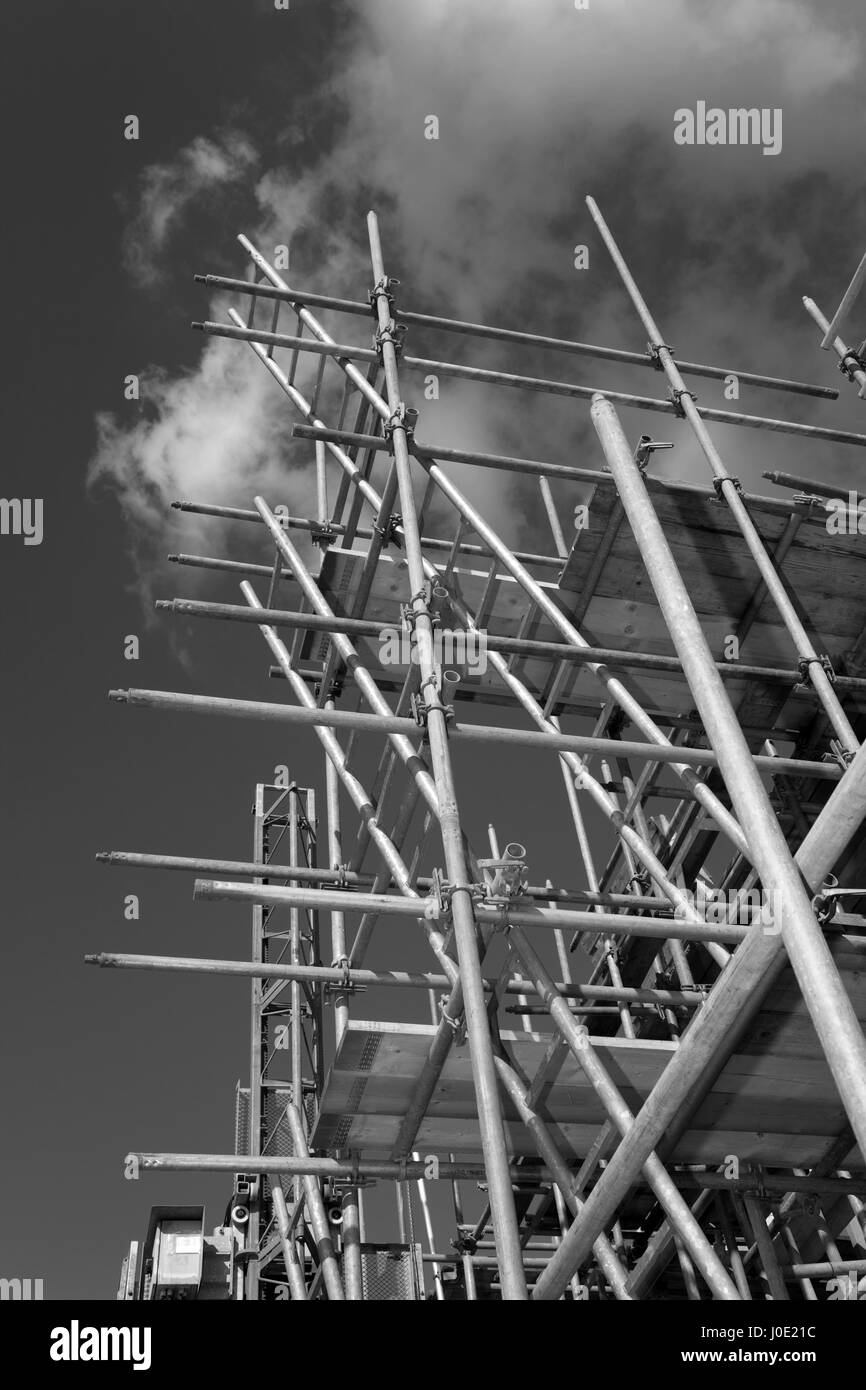 scaffolding construction with  blue sky - Stock Image