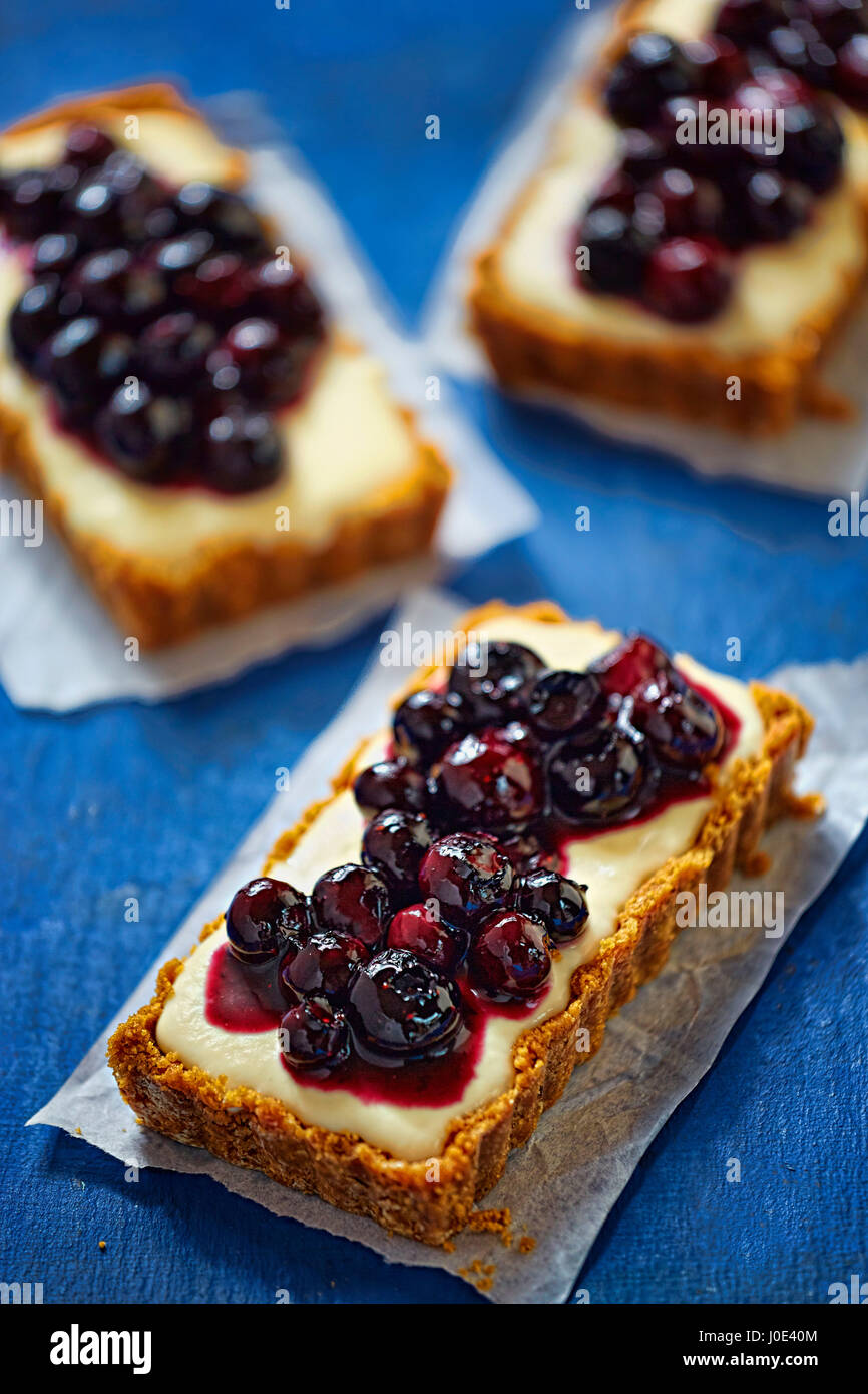 Tarts with custard and blueberries - Stock Image