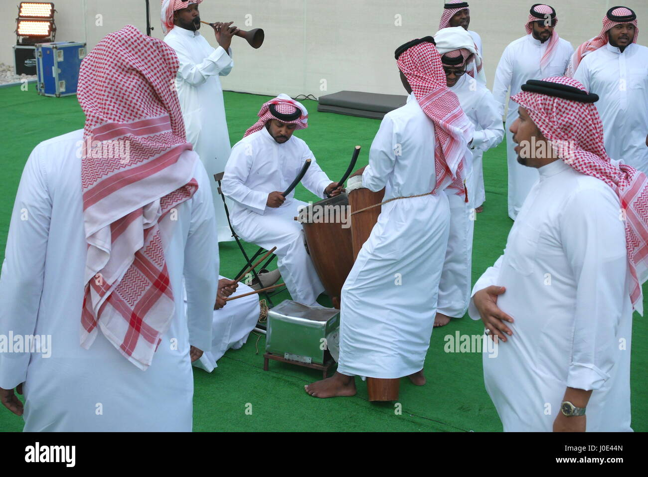Traditional Bahrain dance accompanied by drums and mizmar (wind instrument). The men are wearing dishdashas, ghutra Stock Photo