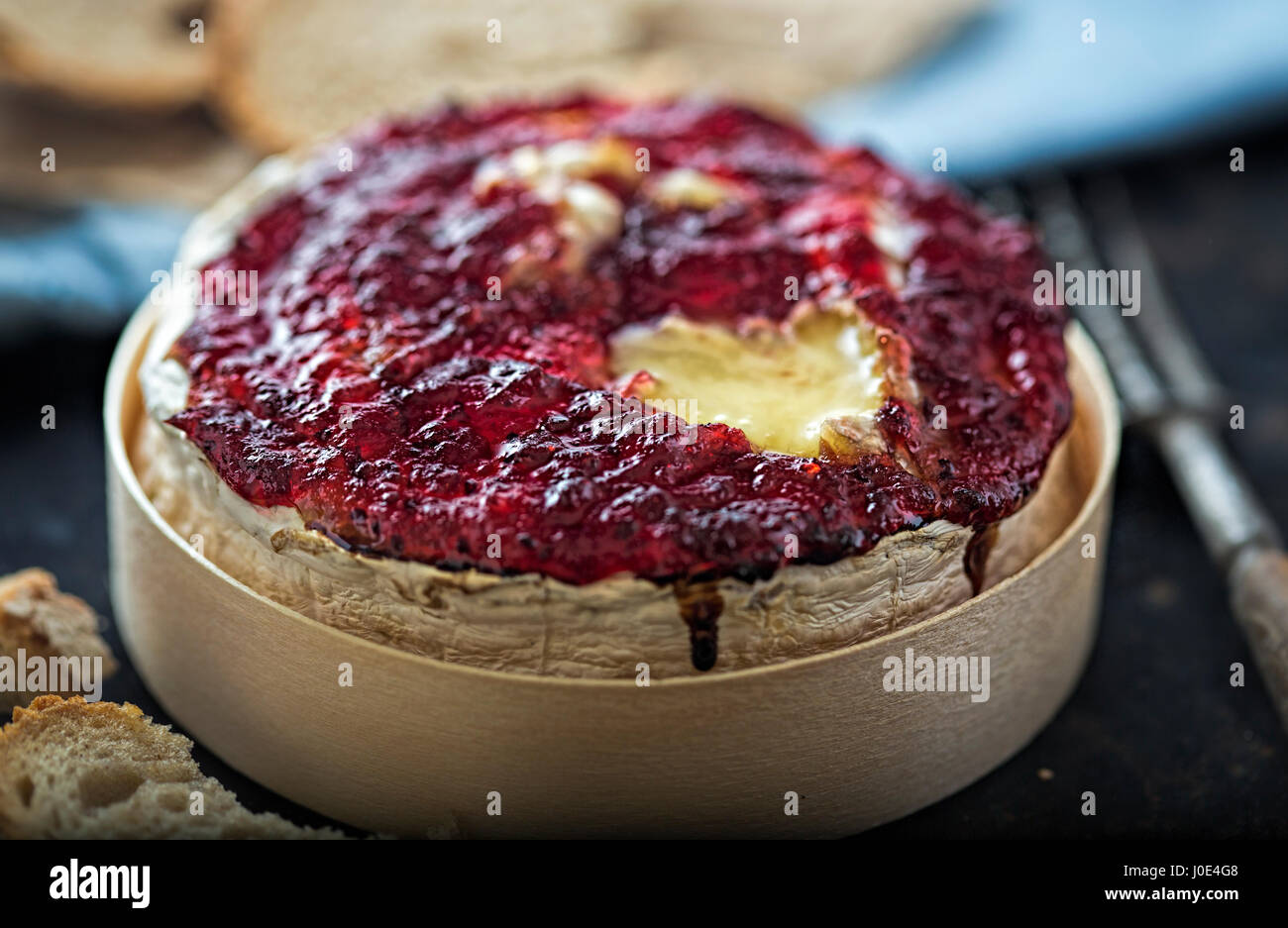 Baked camembert with cranberry sauce - Stock Image