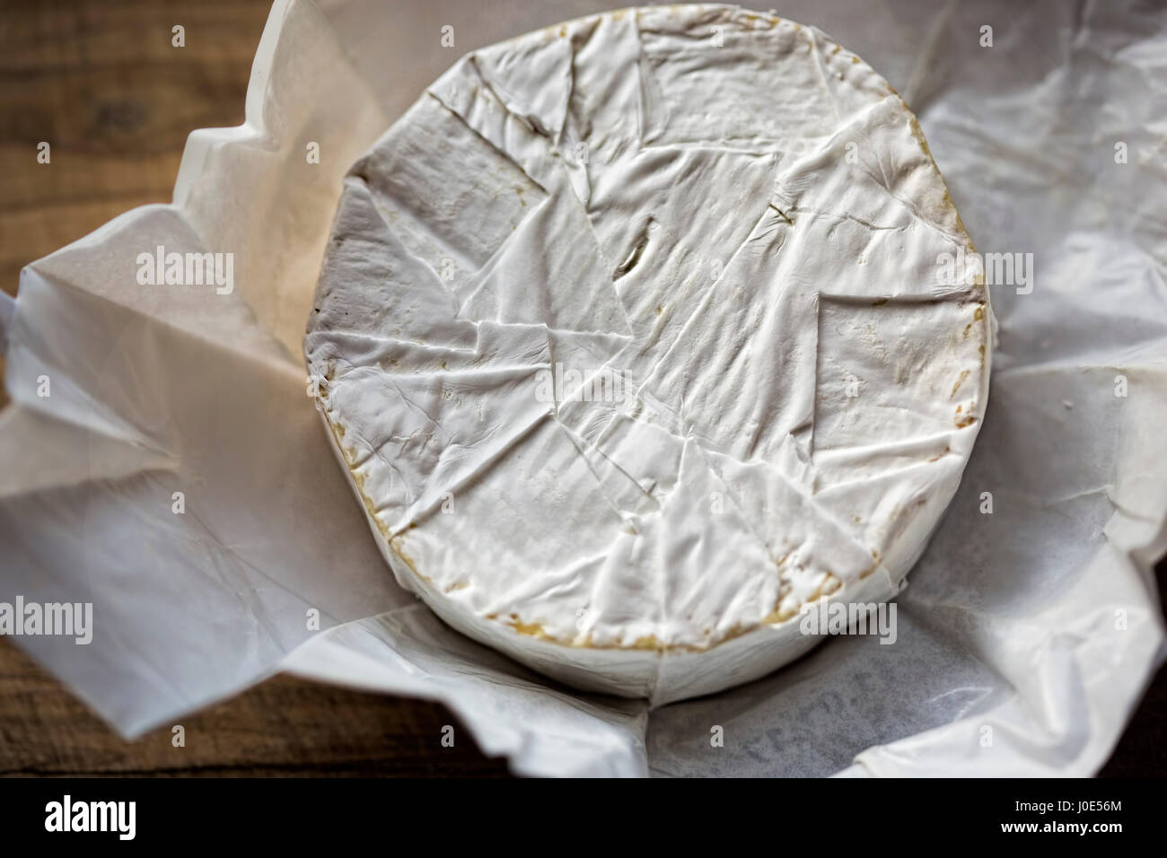 Brie cheese on wooden board - Stock Image
