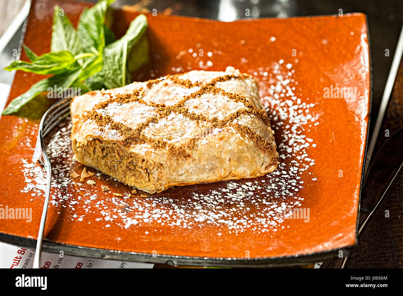 Chicken and cinnamon Moroccan savoury sweet filo pastry Stock Photo