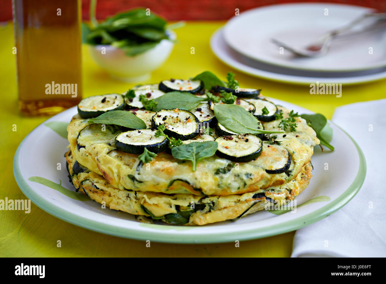 Courgette tortilla with baby spinach - Stock Image