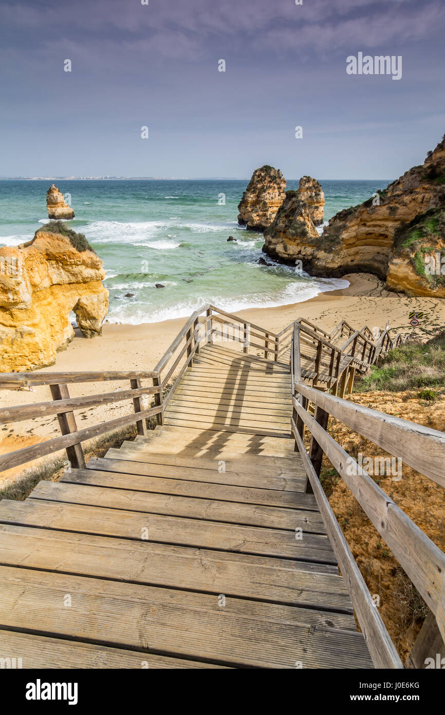 View of the beach of Dona Ana from the top of the wooden stairs that lead to the beach. Lagos, Algarve, Portugal. - Stock Image