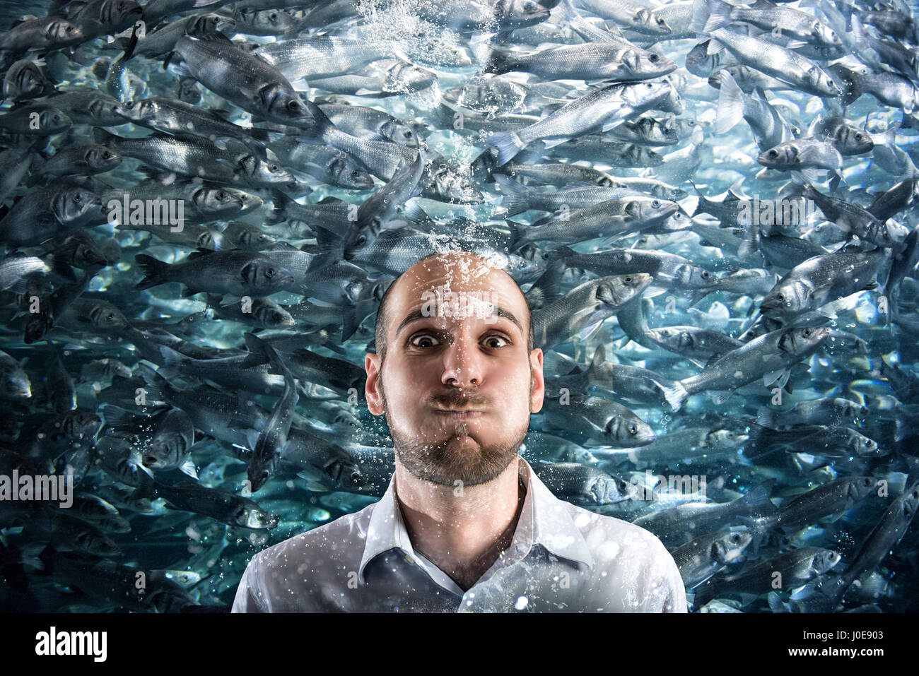 Sinking to the economic crisis concept - Stock Image