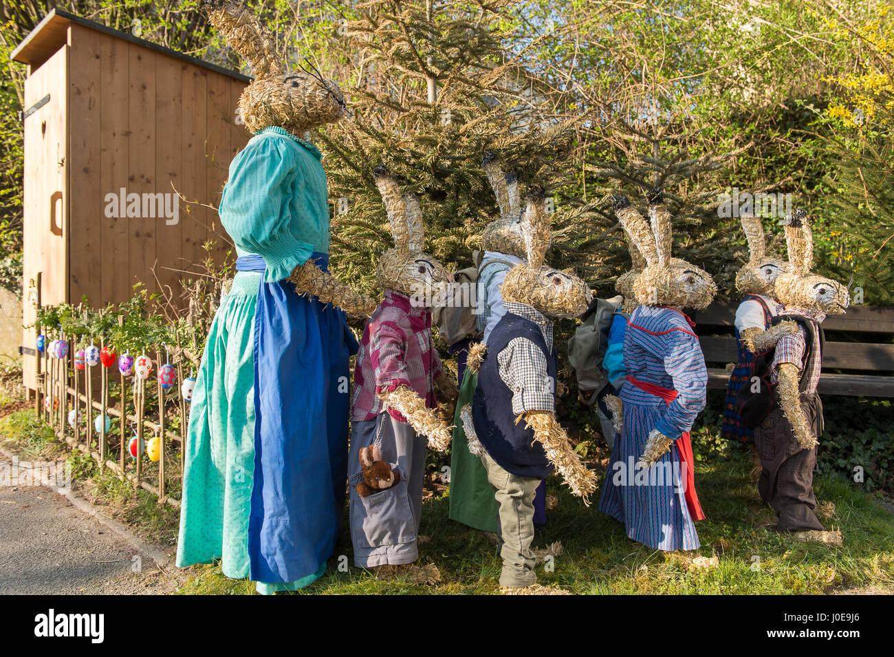 Easter bunnies as straw dolls, schoolchildren with teacher in bunny school, Niederneuching-Ottenhofen, Upper Bavaria, - Stock Image